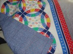 Blue backing on Baby Quilt