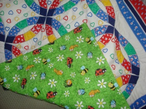 Green backing on Baby Quilt