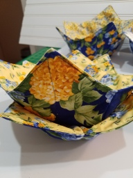 Blue and yellow microwave cozies